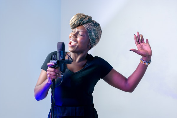 woman singing in the microphone