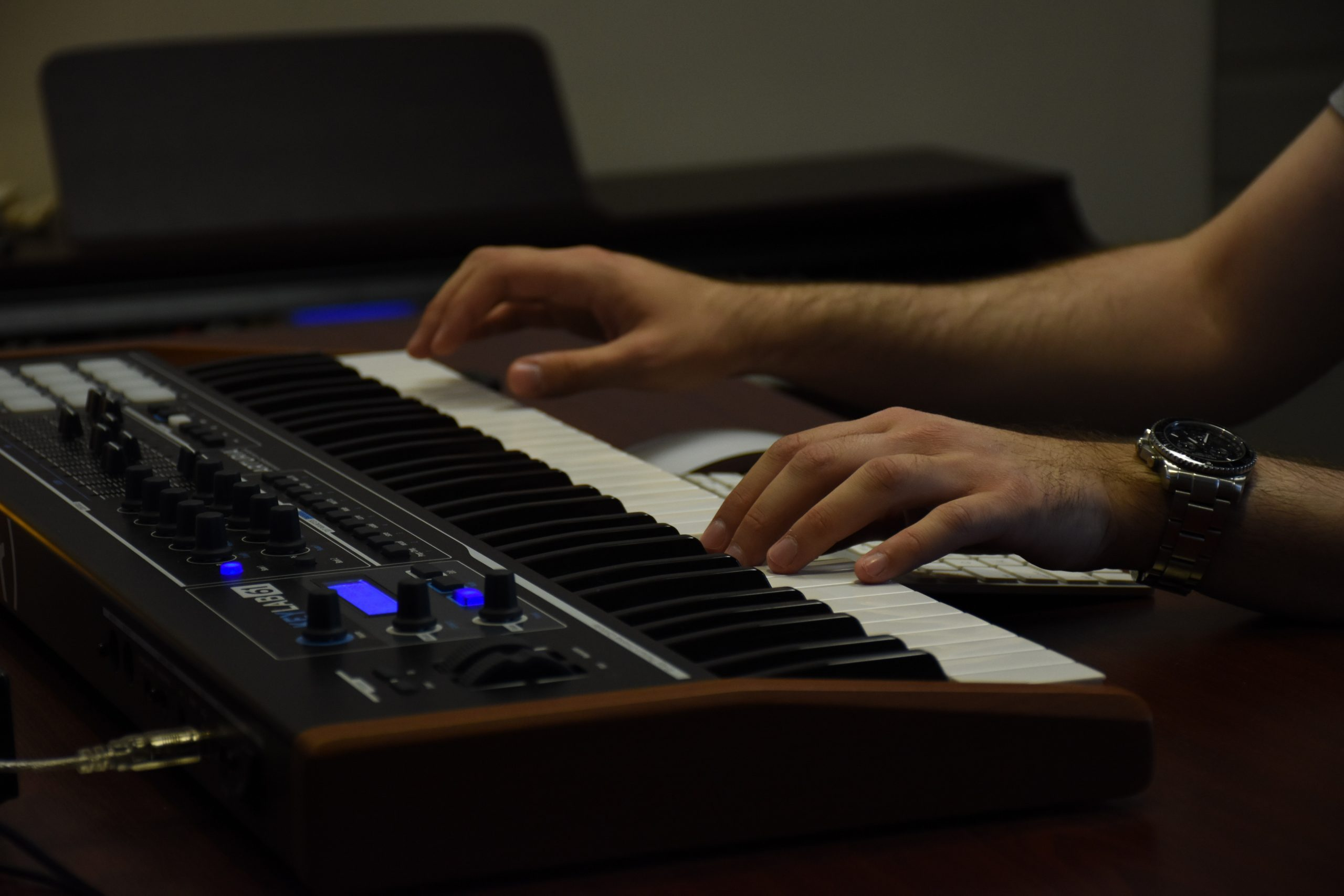 person playing electronic piano