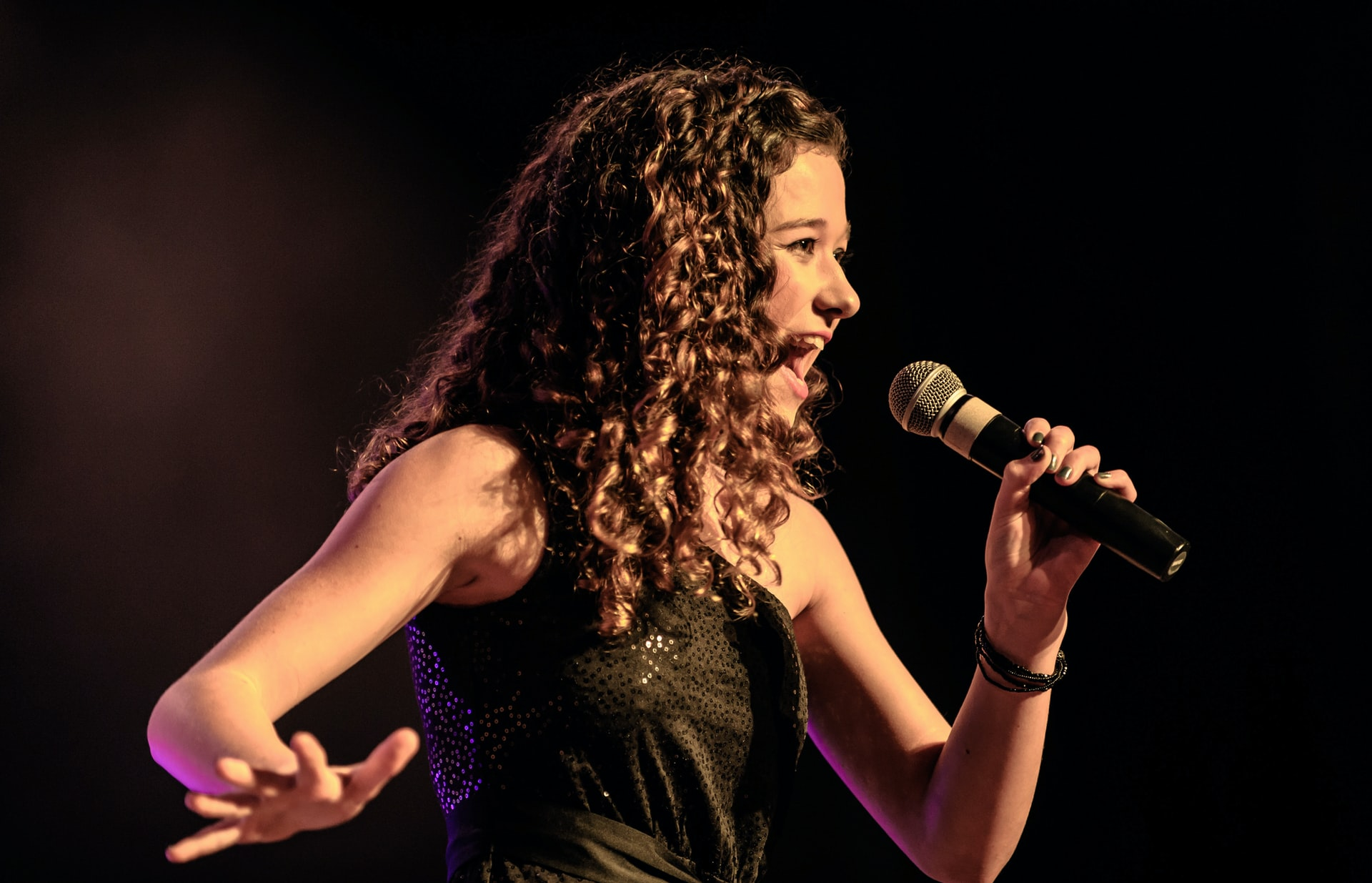 singer using a wireless microphone
